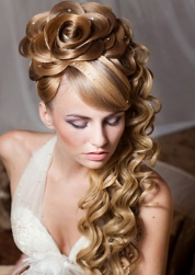 Large flower hairdo wedding with beautiful long curly hair.PNG