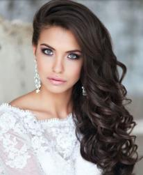 Beautiful large curly wedding hairstyle with very long swept bang pulled to one side gives you a glameous look.JPG