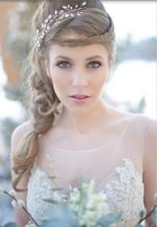 Winter bride updo with crystal headband with braided hearband with braid on the side.JPG
