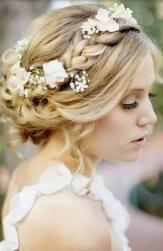 Natural look bridal haistyle with beautiful fresh flowers and braids with long side bangs.JPG