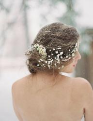 Natural wedding hairstyle with low hairdo with small fresh flowers.JPG