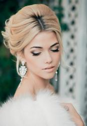 Snow theme wedding with low updo with long side bangs.JPG