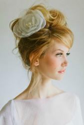 Messy yet sexy wedding hairstyle with loose bun updo with beautiful floral hairclip with perls.JPG
