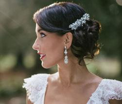 Bridal low updo hairstyle for winter wedding with beautiful crystal hairclip.JPG