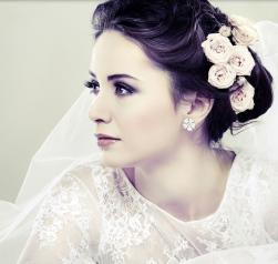 Elegant winder bridal hairstyle with fresh roses on low updo hairstyle with veil.JPG
