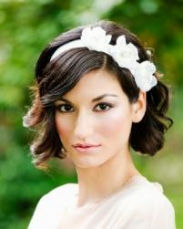 Short wavy bridal hairstyle with white floral headband with side bang.JPG
