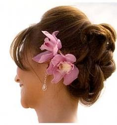Beach bridal updo photos with big pink flowers.JPG