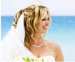 photo of beach wedding hairstyle with veil and flowers.JPG