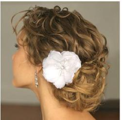 Romantic wedding updo photo with big white flower clip.JPG