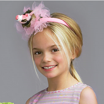 Simple low ponytail with pink head band with big flowers.PNG