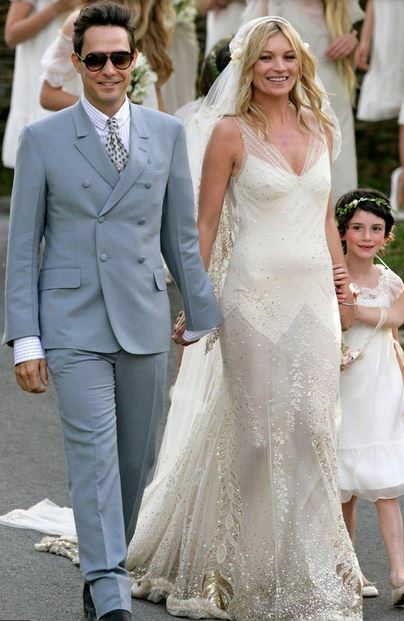 Kate Moss wedding with her beautiful cream wedding dress with gold feather patterns.JPG