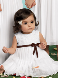 Adorable flower girl with white hairclip.PNG
