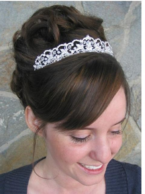Elegant and high wedding updo with big terria and long side bang.JPG