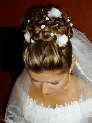 pictures of wedding hairstyle with full of floral hairclips and veil.JPG