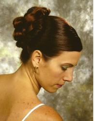Simple wedding hairstyle with bang pulled back.JPG