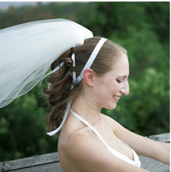 Young wedding hairstyle with tail with whtie ribbons.PNG
