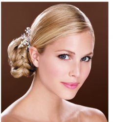 Low braid updo for wedding with long side bang.PNG