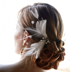 Low bride updo with feather hairclip picture.PNG