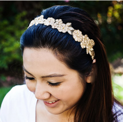 Photo of wedding down hairstyle with gold floral head band.PNG