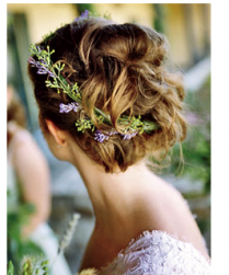 Simple light wedding hairstyle with fresh flowers in purple.PNG