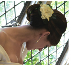Simple wedding hairstyle with fresh rose hairclip with long sweept bang pulled to the back.PNG