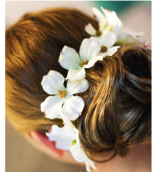 Beach bridal hairstyle with fresh white flowers with yellow centers.PNG
