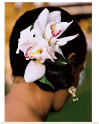 Beach wedding hairstyle with big fresh flowers hair clip.PNG