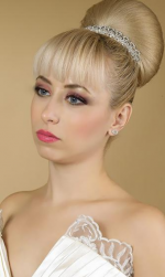 Wedding classic updo with big knot with long bang with blonde wedding hair.PNG