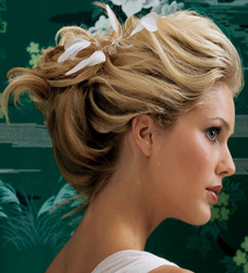 Blonde bridal updo with white lfowers.PNG