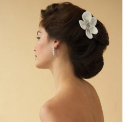 Elegant wedding hairstyle with white floral hair clip picture.PNG
