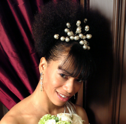 Black wedding hairstyle with white pearl hairclip.PNG