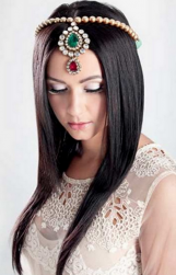 Indian wedding hairstyle with beautiful Indian hair jewelry with straight long hairstyle with very long side bangs.PNG