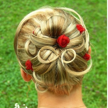Beautiful bridal hairdo with small fresh red flowers.PNG