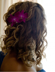 Long curly bridesmaide hairstyle with fresh tropical flowers.PNG