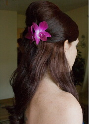 Picture of bridesmaid half updo with fresh flowers.PNG