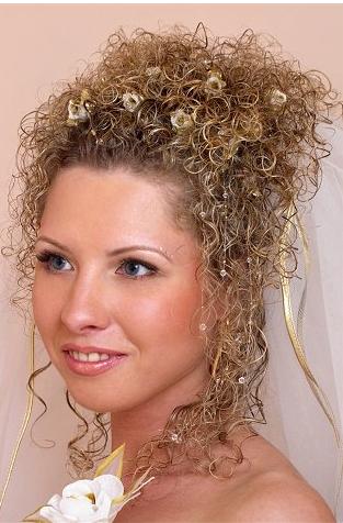 Small curly wedding updo hairstyle picture with small fresh flowers.PNG