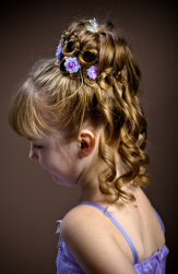 Elegant flower girl hairstyle updo with purple flowers.PNG