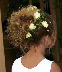 Curly flower girl hairstyle updo with curls and white roses.PNG