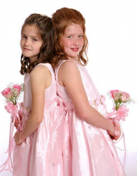 Two flower girls updo with hair down and bangs pulled back.PNG