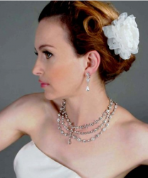 Bridal lower updo with a vintage style and floral hairclip.PNG