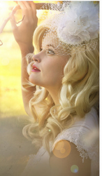 Blonde long curly bride hairstyle with big white floral hair clilp pictures.PNG