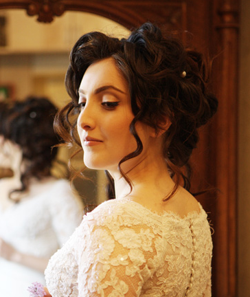 Curly wedding updo with small pearls.PNG