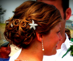 Beach bridal hairdo with crystal starfish hairclip images.PNG