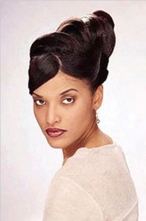 Photograph of black bridal hair w/ french roll