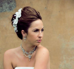 Classic wedding updo with front pulled back and floral hairclip in white.PNG