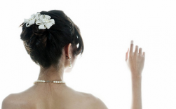 Elegant Asian bride hairdo with white flowers hair clilp image.PNG