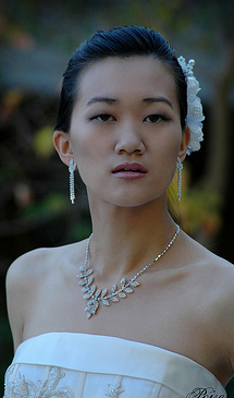 Pretty asian bride updo with hairclip on the back side.PNG