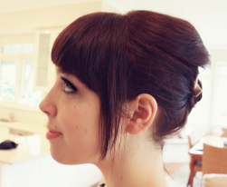 Cute bridesmaid updo with long side bangs.PNG