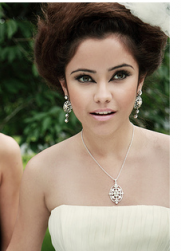 Modern bride updo with cream rose hairclip.PNG