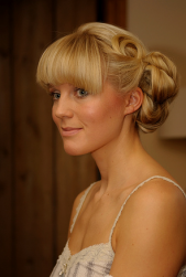 Cute and classy wedding hairstyle with bang.PNG